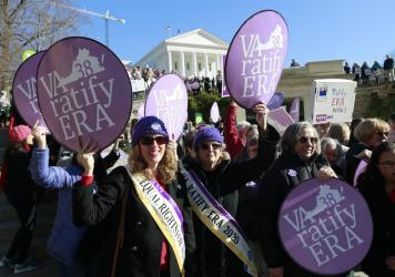 Equal Rights Amendment supporters demonstrate outside the Virginia State Capitol in Richmond on Jan. 8. The state is close to ratifying the ERA, even as the measure's future nationally remains in doubt.