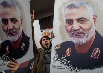 People hold posters showing the portrait of Maj. Gen. Qassem Soleimani at a protest outside the U.S. Consulate on Jan. 5 in Istanbul, Turkey.