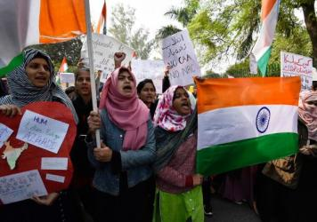 Demonstrators protest against the Citizenship Amendment Act near Jamia Millia Islamia on Dec. 15 in New Delhi.