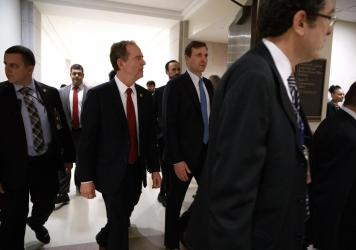 House Democratic impeachment manager Rep. Adam Schiff (second from left) leaves a news conference on Capitol Hill on Tuesday.
