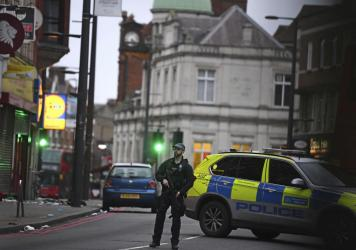 """London police say officers shot and killed a suspect in a """"terrorist-related"""" stabbing incident Sunday."""