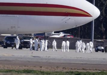 195 U.S. citizens who were evacuated from Wuhan, China, were placed in quarantine at March Air Reserve Base in Riverside County, Calif. New quarantine orders and travel restrictions intended to prevent the spread of coronavirus were announced Friday.