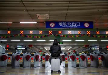 Millions of Beijing residents are expected to return to the capital city after going away for the Lunar New Year. Above: A traveler at Beijing's West Railway Station on Sunday.
