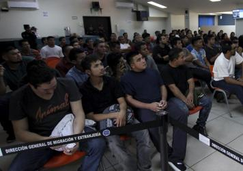 Salvadoran deportees, pictured in June 2018, listen to instructions from an immigration officer at La Chacra Immigration Center in San Salvador, El Salvador. A Human Rights Watch Report found that 138 repatriated Salvadorans have been killed since 2013.