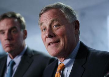Sens. Richard Burr, R-N.C., (right) and Mark Warner, D-Va., — pictured in September 2018 — released a report on election security Thursday.