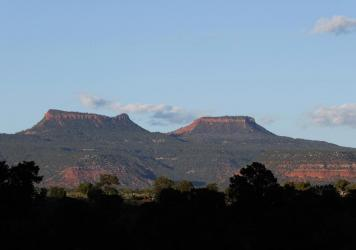 The two bluffs that inspired the name of the Bears Ears National Monument, seen at sunset outside Blanding, Utah. On Thursday, more than two years after the Trump administration announced plans to shrink the monument and others, federal managers have fin