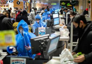 People wearing protective masks shopping at a supermarket in Shenyang in China's northeastern Liaoning province, on Monday.