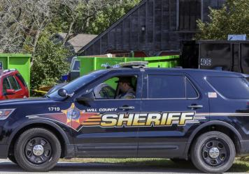 A patrol car is stationed outside the home of deceased Ulrich Klopfer in Crete, Ill., on Sept. 19, 2019. Indiana Attorney General Curtis Hill presided over the mass burial Wednesday of the remains of more than 2,400 fetuses found last year at the suburba