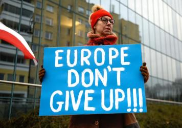A pro-democracy protestor holds a placard ahead of a meeting between the Vice President of the European Commission for Values and Transparency, Vera Jourova, and the First President of Poland's Supreme Court, Malgorzata Gersdorf, in front of the Supreme