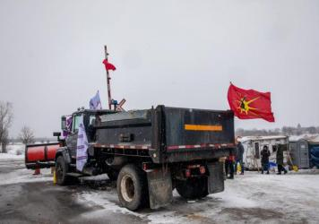 A truck sits parked at railway tracks during a protest near Belleville, Ontario, Canada, on Thursday. Demonstrators have been disrupting railroads and other infrastructure across Canada for more than a week to protest the planned Coastal GasLink pipeline