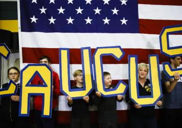 "Attendees hold letters that read ""CAUCUS"" during a campaign event for Democratic presidential candidate former South Bend, Ind., Mayor Pete Buttigieg in Iowa earlier this month."