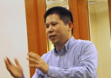 Prominent Chinese rights advocate Xu Zhiyong speaks during a meeting in Beijing in a handout photo from 2013. Xu has been detained in southern China.