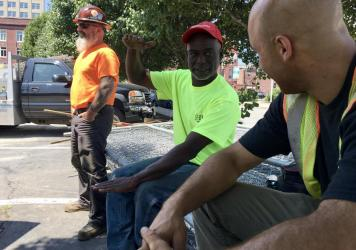 Calvin Brandford (center) is a certified minority contractor who has run an excavation business north of Boston for almost 30 years. Brandford said getting state-funded work as a subcontractor is very hard and often comes with a serious drawback: not get
