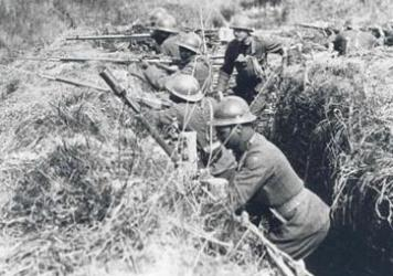 "Soldiers of the 369th Infantry practice in France during World War I. They are wearing French ""Adrian"" helmets and using French issued rifles and equipment."