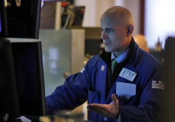 Specialist Mark Fitzgerald works on the floor of the New York Stock Exchange, Monday, Feb. 24, 2020. Markets are down across Europe, Asia, and the U.S. as the virus spreads to more countries around the world.