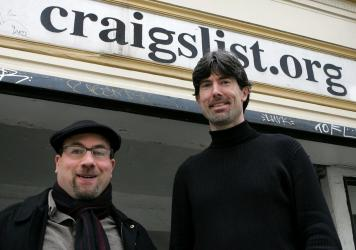 Craigslist founder Craig Newmark (L) and CEO Jim Buckmaster pose in front of the Craigslist office March 21, 2006 in San Francisco. The site has become a behemoth but changed little aesthetically.