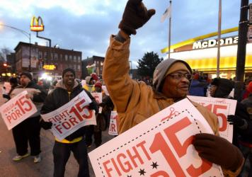 Demonstrators rally for better wages outside a McDonald's restaurant in Chicago in December 2013.