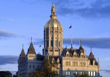 "Hartford is home to the Connecticut State Capitol and state legislature — as well as to major U.S. insurance firms. In 2019, those insurers spent what it took to defeat Connecticut's version of a ""public option"" in health care, despite strong support a"