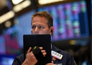 Traders work during the opening bell at the New York Stock Exchange on Thursday. Wall Street stocks opened sharply lower amid fears the coronavirus will grow into a significant international health crisis.