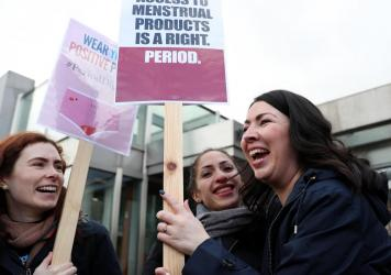 Scottish Parliament member Monica Lennon (right) joins supporters of the Period Products bill she sponsored, at a rally outside Parliament in Edinburgh on Tuesday. The legislation would make Scotland the first country in the world to make products like p