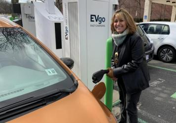 Pam Frank, CEO of ChargEVC, drives a bright Orange Chevrolet Bolt because she wants others to notice its an electric car.