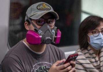 A shortage of surgical masks and an abundance of concern about the new coronavirus has led some Hong Kongers to wear industrial respirators in public.
