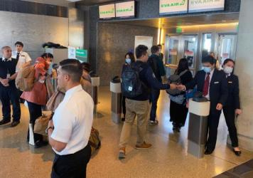 Humans — workers and flight crews as well as passengers — can be exposed to any number of pathogens at airports. EVA Air employees are seen wearing face masks at the Los Angeles airport in February amid the coronavirus outbreak. U.S. officials advise