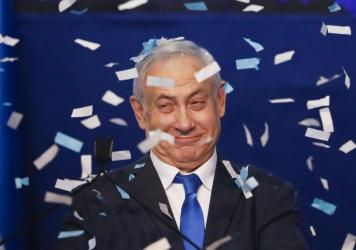 Israeli Prime Minister Benjamin Netanyahu smiles after first exit poll results for the Israeli elections at his party's headquarters in Tel Aviv, Israel, on Monday.
