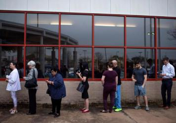 Voters wait in line to cast their ballots during the presidential primary in Houston, Texas on Super Tuesday, March 3.