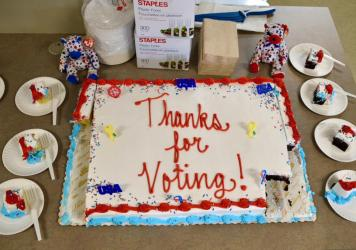 """In Mendon, Vt., the first voter arrived 10 minutes before polls opened at 8 a.m. """"She was so excited,"""" said Town Clerk Nancy Gondella, """"since she realized she'd get the first piece of cake."""""""