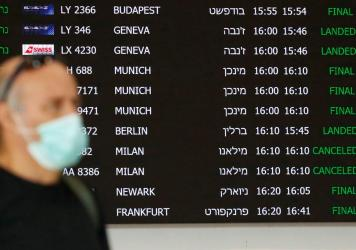 A flight information board displays canceled incoming flights from Italy at Ben Gurion International Airport, near Tel Aviv, Israel, last month. Airlines are slashing hundreds of flights amid fear of the spreading coronavirus.