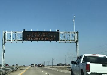"""Highway sign that reads, """"Puff, puff? Pass the keys to a designated driver."""""""