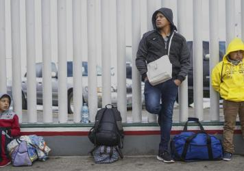 Honduran migrants wait in line to plead their asylum cases earlier this month at a border crossing in Tijuana, Mexico.