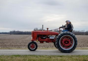 Victoria Iler, a junior at South Central High School, learns to drive an old 1940 Farmall tractor ahead of Drive Your Tractor To School Day.