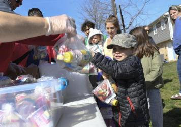 "Kids whose schools are shut down in Anne Arundel County, Md., receive food in Annapolis as part of a program to ease the burden of feeding students while schools are closed because of the coronavirus. President Trump told Americans to ""engage in schoolin"