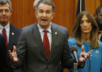 Virginia Gov. Ralph Northam, (front) announced schools in the state will remained closed for at least the rest of the academic school year.