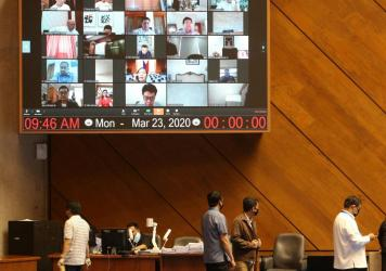 A huge video screen shows members of the Philippine Congress participating in a special session via video conference in Manila on Monday to discuss a proposed emergency power to be given to President Rodrigo Duterte to tackle the COVID-19 coronavirus out