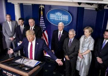 President Trump, center left, speaks during a Coronavirus Task Force news conference in the briefing room of the White House on Friday, March 20, 2020.