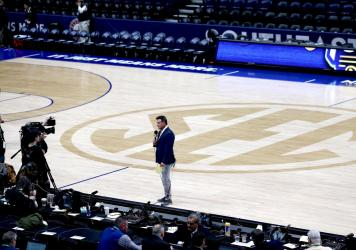 ESPN's Karl Ravech reports on the cancellation of the SEC Men's Basketball Tournament on March 12, in Nashville. With no live sports to show, the network is scrambling to fill the time. Its offerings now include diversions like cherry pit spitting and ma
