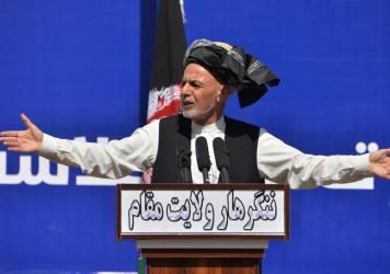 Afghan President Ashraf Ghani speaks earlier this month in Jalalabad. Ghani's dispute with Abdullah Abdullah over election results has been cited as one reason for the delay in organizing prisoner releases with the Taliban, a key stipulation in a peace d