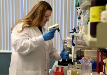 Regeneron Pharmaceuticals, headquartered near Tarrytown, N.Y., is just one of the companies now working to identify and reproduce large quantities of antibodies that could prevent or treat COVID-19. Senior R&D Specialist Kristen Pascal works on COVID-19