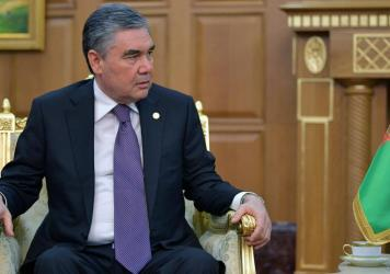 Turkmenistan's President Gurbanguly Berdymukhamedov, seen here in Ashgabat in October 2019, earlier offered remedies to combat the virus from a book on medicinal plants that he authored.