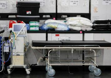 A ventilator alongside medical supplies and a stretcher is displayed before a news conference at the Javits Center in New York City on March 23.