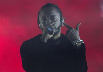 Kendrick Lamar performs at the 2017 Coachella festival. Though his 2015 album <em>To Pimp A Butterfly</em> wore its jazz influence on its sleeve, 2017's <em>DAMN.</em> displays Lamar's deep investment in the way jazz can evolve.