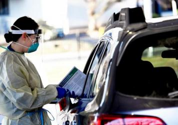 Nurse Alyssa Anderson administers the COVID-19 test to patients in their cars at a Saint Francis Hospital & Medical Center drive-through mobile center in Hartford, Conn.