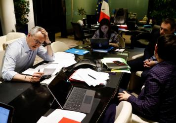 In Paris, French Economy and Finance Minister Bruno Le Maire (left) speaks on the phone with his German counterpart as his advisor Juliette Oury (center) and cabinet deputy director Thomas Revial (second right) and French Treasury director Odile Renaud-B