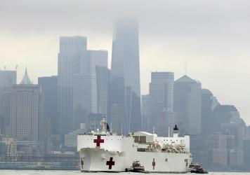 The Navy hospital ship USNS Comfort is treating more than 50 patients from New York City, including 10 critically ill people with COVID-19 who were transferred to the ship from a hospital in Queens on Tuesday.