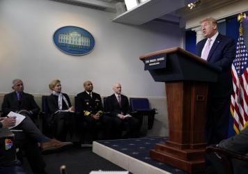 President Donald Trump speaks during a coronavirus task force briefing at the White Houseon Friday. Seated from left, Director of the National Institute of Allergy and Infectious Diseases Dr. Anthony Fauci, White House coronavirus response coordinator Dr
