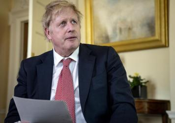 In this handout photo issued by 10 Downing Street, Britain's Prime Minister Boris Johnson speaks from 10 Downing Street praising NHS staff in a video message, after he was discharged from the hospital a week after being admitted with persistent coronavir