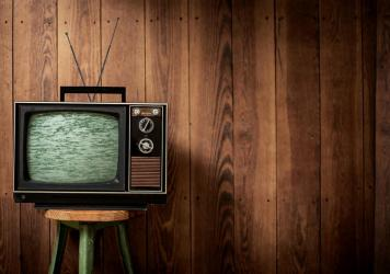 People are watching more TV and adding new streaming services to cope with isolation — but statistics show they're tending to re-watch old favorites.